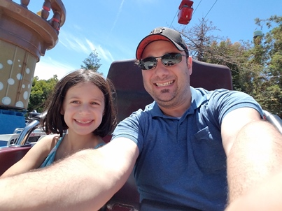 Avery and Daddy on ride