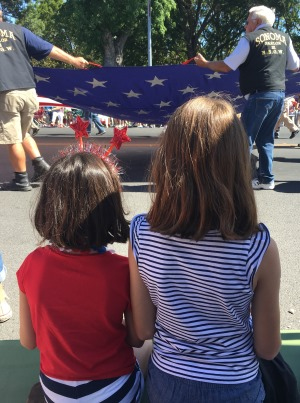 girls watching 4th of July parade
