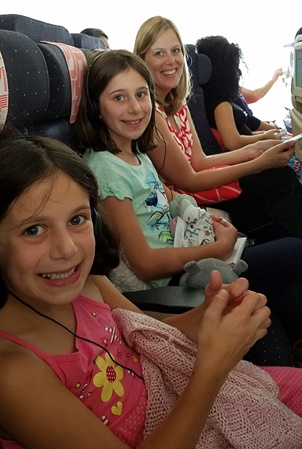 girls and Mommy on plane