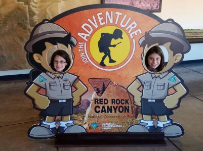 girls-with-red-rock-canyon-sign