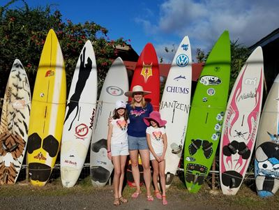 mommy-and-girls-by-surfboards