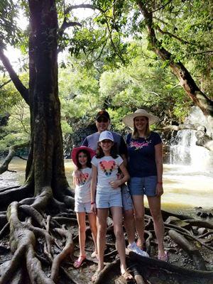 family-at-waterfall
