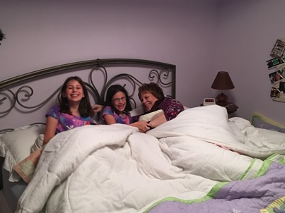 girls-and-sandy-in-bed